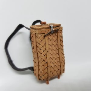 Miniature birch bark backpack with a working lid.  Card stock, wire, wood, ribbon.