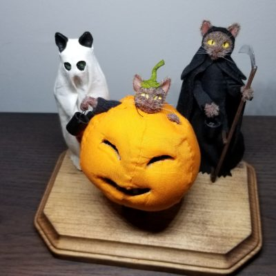 Miniature cat diorama of trick or treaters.