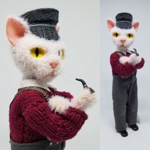 Miniature cat fisherman.  Wire, super sculpey, acrylic paint, flock fiber, fabric and yarn.